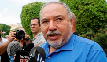 Avigdor Lieberman speaks to the press during his visit to the settlement of Maale Adumim in the occupied West Bank on September 8, 2019.