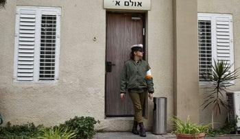 Illustration: A Military Police soldier stands outside a military court at IDF headquarters in Tel Aviv, June 26, 2016.