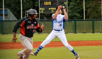Pitcher Eric Brodkowitz making a catch for Israel against The Netherlands in Germany, September 11, 2019.