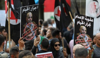 Former detainees of the pro-Israel South Lebanon Army hold pictures of al-Fakhoury during a demonstration against his return, Beirut, September 12, 2019.