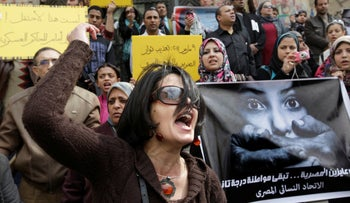 File photo: Egyptian activist shouts anti-military Supreme Council slogans during a demonstration in front of Cairo's high court, March 16, 2012.