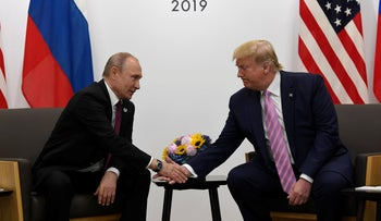 Donald Trump and Vladimir Putin during a bilateral meeting on the sidelines of the G-20 summit in Osaka, Japan, June 28, 2019.