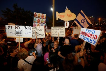 Demonstrators in Goren Square, Petah Tikva, protesting Netanyahu's alleged role in a mega defense corruption scandal, accusing the Attorney-General of collaborating in his defense. 5 August 2017