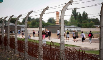 Visitors are seen at the former concentration camp Sachsenhausen in Oranienburg, eastern Germany on August 7, 2019.