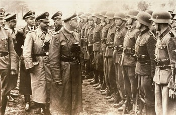 Heinrich Himmler reviews troops of the Galician SS-Volunteer Infantry Division Michael Karkoc in June 1944.