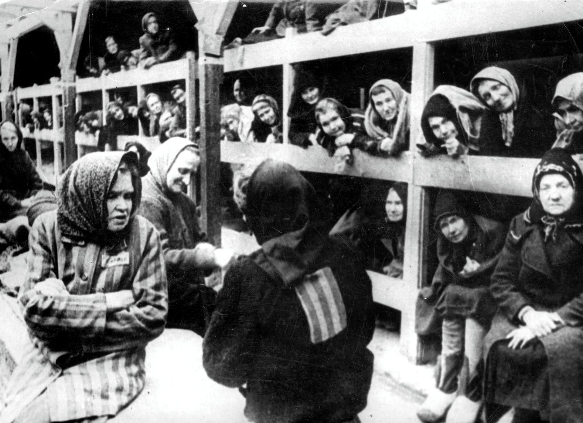 Women are pictured in their barrack after the liberation in January 1945 of the Auschwitz concentration camp.