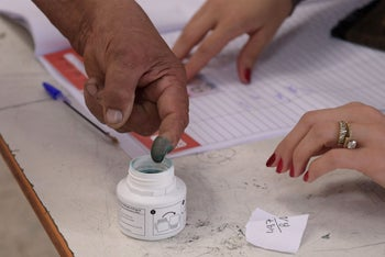 Tunisian voter dips his finger in ink after casting his ballot, September 15, 2019.