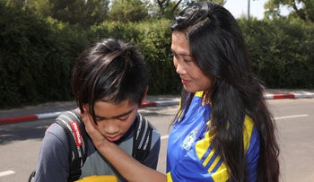 Ofresina Koanka and her son, Michael James, following their release from custody in July.
