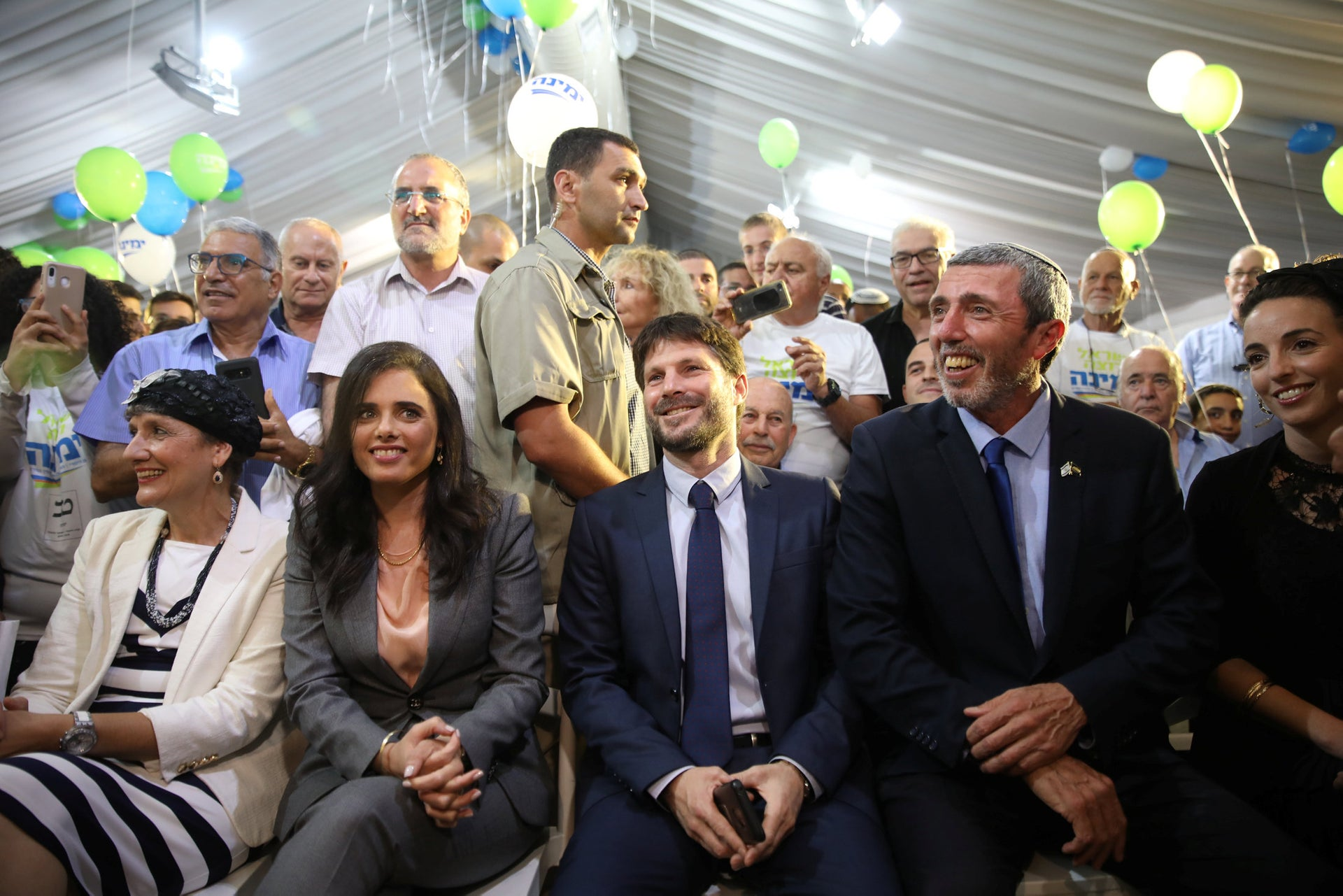 """The launch of the """"Yamina"""" party, with Ayelet Shakked and Bezalel Smotrich in the center, flanked by Rabbi Rafi Peretz to their right"""