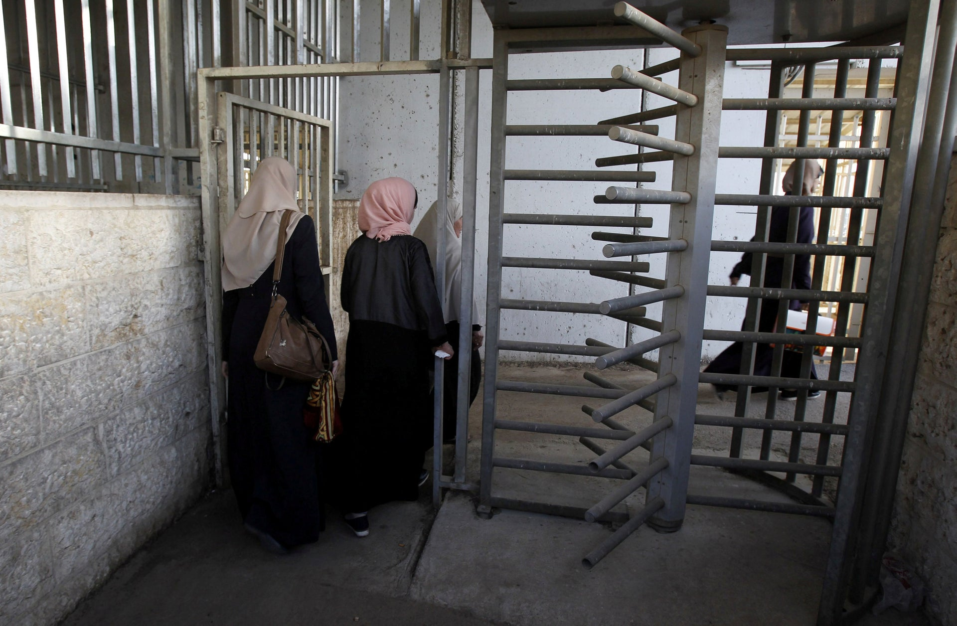 Palestinian women crossing an Israeli checkpoint between the West Bank town of Bethlehem and Jerusalem, May 2018.