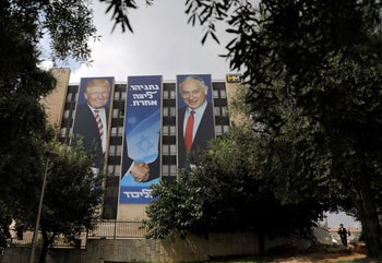 A Likud party election campaign banner depicting Israeli Prime Minister Benjamin Netanyahu shaking hands with U.S. President Donald Trump is seen in Jerusalem September 15, 2019.