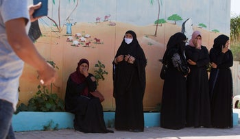 Women from unrecognized Bedouin villages in the Negev wait at a polling station in Tel Sheva in southern Israel, September 17, 2019.