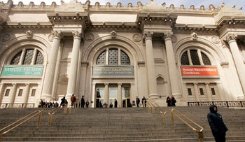 Visitors walk along the steps of the Metropolitan Museum of Art in New York, March 6, 2006.