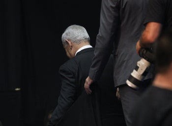Prime Minister Benjamin Netanyahu exiting the stage at the Likud party's post-election rally in Tel Aviv, September 18, 2019.