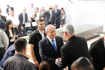 Netanyahu and Gantz shaking hands at a memorial service for late President Shimon Peres, September 19, 2019.