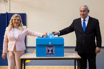Prime Minister Benjamin and his wife Sarah casts their votes at a voting station in Jerusalem on September 17, 2019.