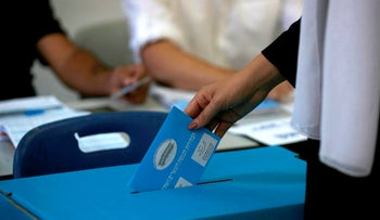 A member of the Israeli Druze community casts her ballot during Israel's parliamentary elections on September 17, 2019, in Daliyat al-karmel in northern Israel.