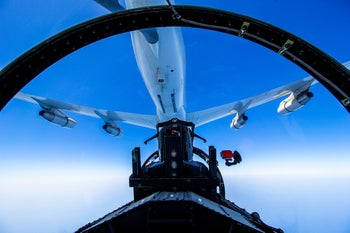 An Israel Air Force F-15 refuels mid-air during Exercise Cobra Warrior