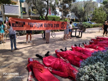 Artists protesting against endangered animal extinction, climate change crisis, Tel Aviv, September 20, 2019.