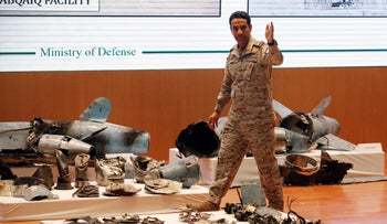 Saudi military spokesman Turki al-Malki displays what he described as an Iranian cruise missile and drones used against Saudi installations, Riyadh, September 18, 2019.