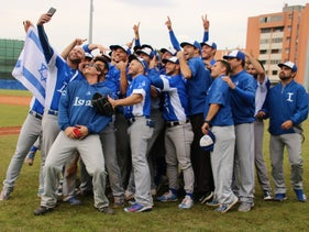 The Israel national baseball team celebrating after defeating South Africa in Parma, Italy, to qualify for the 2020 Olympics, September 22, 2019.