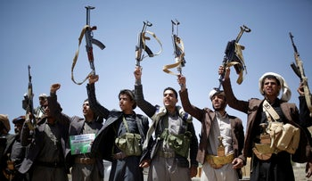 Shiite Houthi tribesmen hold their weapons as they chant slogans during a tribal gathering showing support for the Houthi movement, in Sanaa, Yemen, September 21, 2019.