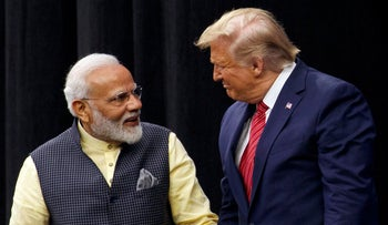 """President Donald Trump arrives to speak at the """"Howdy Modi: Shared Dreams, Bright Futures"""" event with Indian Prime Minister Narendra Modi at NRG Stadium, Sunday, Sept. 22, 2019, in Houston"""