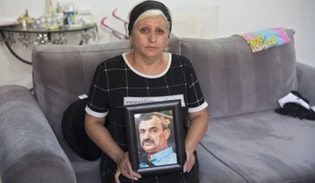 Yegodayev's widow Margarita with his photo, 2018.
