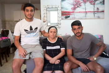 Yagodayev's widow with his two sons, Eliezer (right) and Sharon, 2018.