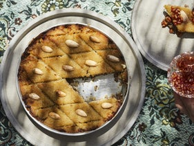 """Kibbeh saniyeh with almonds and pomegranate jam. """"The tart and not overly sweet taste of the jam goes wonderfully with tahini and meat dishes."""" Styling by Nurit Kariv."""