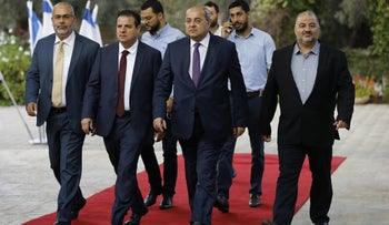 Members of the Joint List, including Ayman Odeh, second from left, walking toward the President's Residence in Jerusalem, September 22, 2019.