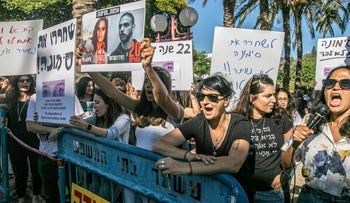 Supporters of Simona Mori demonstrate outside her hearing at the Ramle Magistrate's Court, September 25, 2019.