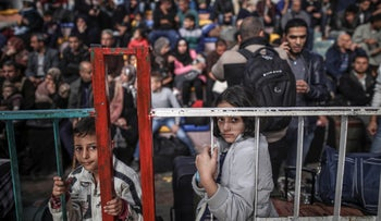Palestinians gather as they await to get permits to cross into Egypt through the Rafah border crossing, in Khan Younis, Southern Gaza strip, 18 November 2017.