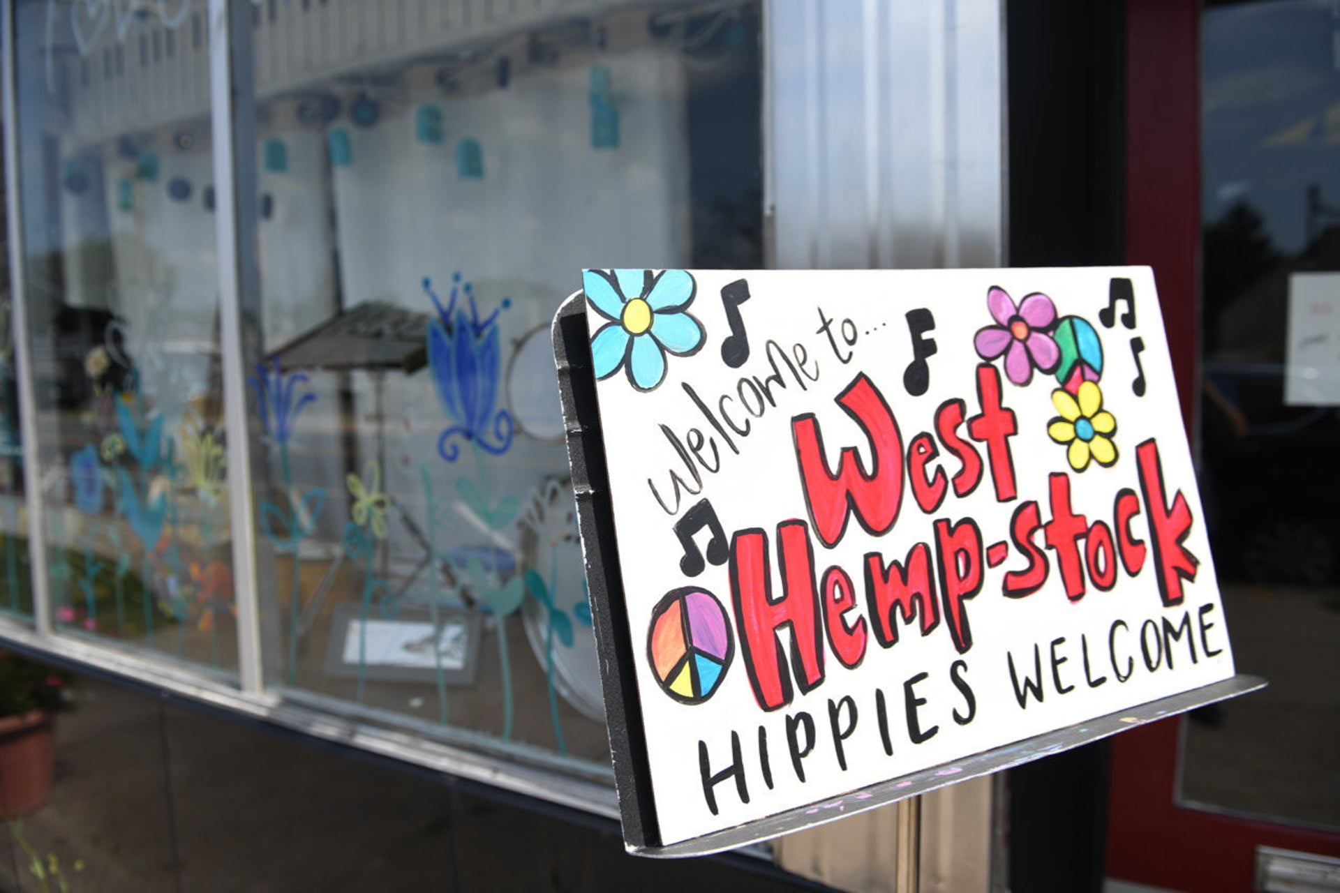A sign outside Creative Corner in West Hempstead marking the 50th anniversary of Woodstock in August.