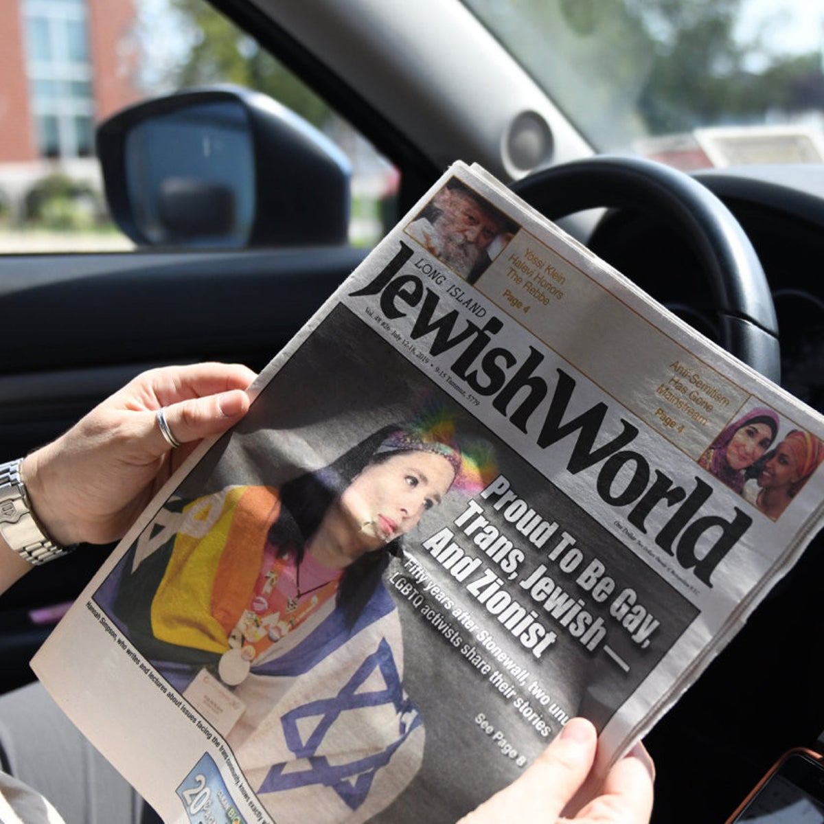 Shlomit Metz-Poolat with a copy of the Long Island Jewish World newspaper that was withdrawn from local restaurants, August 2019.