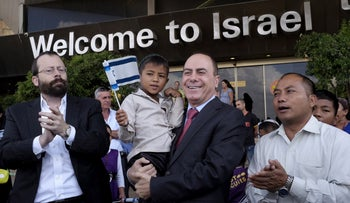Michael Freund, left, and then-Interior Minister Silvan Shalom greeting members of the Bnei Menashe community arriving to Israel, June 2015.