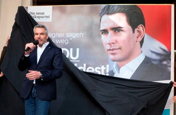 Karl Nehammer, secretary general of the Austrian People's party, speaks as an election poster depicting his party's chairman Sebastian Kurz is unveiled on September 24, 2019 in Vienna