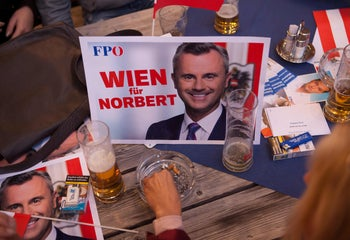 Campaign posters featuring the far-right Freedom Party leader Norbert Hofer during the party's Oktoberfest in Vienna on September 19, 2019