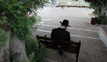 A man praying in Tel Aviv.