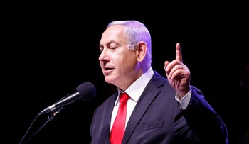 Prime Minister Benjamin Netanyahu speaks at an event marking 40 years to the Shomron Regional Council in the West Bank, July 10, 2019.