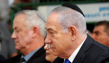 Netanyahu sits next to Gantz at the memorial for Shimon Peres, who formed a national unity government with Yitzhak Shamir in 1984.