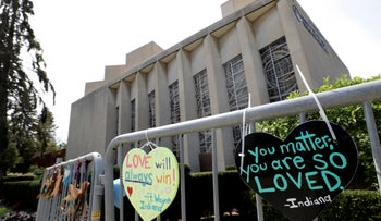 Signs hang on a fence surrounding the Tree of Life synagogue in Pittsburgh, Pennsylvania on September 17, 2019.