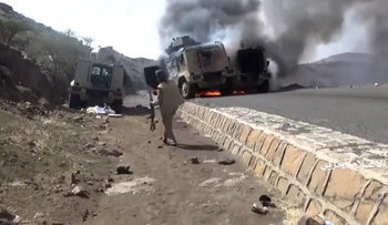 Military vehicles allegedly belonging to pro-government fighters set on fire in a Houthi attack near the southern Saudi region of Najran, Yemen, September 29, 2019.