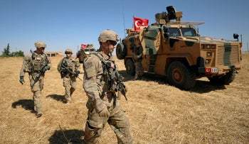 American soldiers walk together during a joint U.S.-Turkey patrol, near Tel Abyad, Syria September 8, 2019