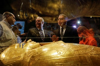 The Gold Coffin of Nedjemankh is seen in front of Egypt's Antiquities Minister Khaled El-Enany and U.S. Charge d'Affaires in Cairo Thomas Goldberger, October 1, 2019.