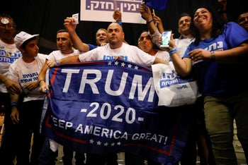 Supporters of the Likud party and its leader, Israeli Prime Minister Benjamin Netanyahu, chant as the await results of the elections in Tel Aviv, Israel. Sept. 17, 2019