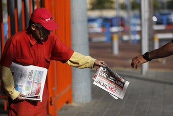 Distributing the Adelson-funded free daily newspaper, Israel Hayom, at a train station in the southern city of Ashkelon, Israel. November 19, 2015