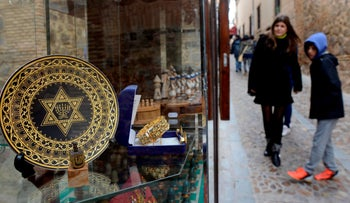 File photo: People stand near a gift shop in the old Jewish Quarters of Toledo, February 2014.