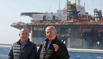 Benjamin Netanyahu speaks alongside Energy Minister Yuval Steinitz during the inauguration of the newly arrived foundation platform for the Leviathan natural gas field in the Mediterranean Sea, Haifa, on January 31, 2019.