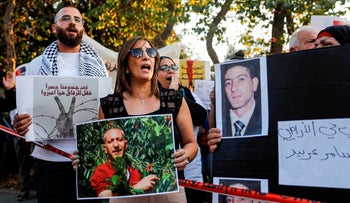 Palestinians demonstrate for Samer al-Arbeed, a Palestinian arrested on suspicion of leading a terrorist cell and then allegedly tortured, near Hadassah Medical Center in Jerusalem, October 1, 2019.